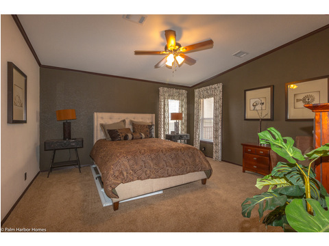 "Palm Harbor Homes ""Great Escape"" offers a large Master bedroom that is located off the rear end of the home. This allows for privacy and is away from the action in the living-room."