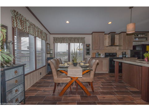 The Great Escape by Palm Harbor Homes has a great open and inviting dining area, along with a LARGE kitchen island perfect for entertaining or family gatherings!!!