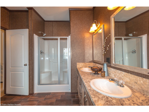 "Your master bathroom also has a large 48"" 1 piece fiberglass shower. And beside the shower is a deep built in cabinet for extra storage for towels, linen, or small children."