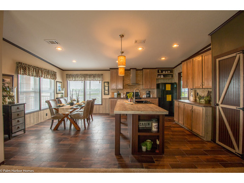 This is the view from the Living-room into the kitchen. The kitchen is the center of attention with the ability to cook, eat and entertain, all in one!! Call 1-888-466-3718 to find a Palm Harbor model center near you.