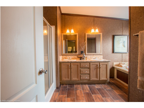 Off of your master bedroom is this beautiful glamour bath, with double porcelain sinks, a bank of drawers, ceramic tile back splash, Moen faucets plus more!!! And notice all the space to move around, always a plus!
