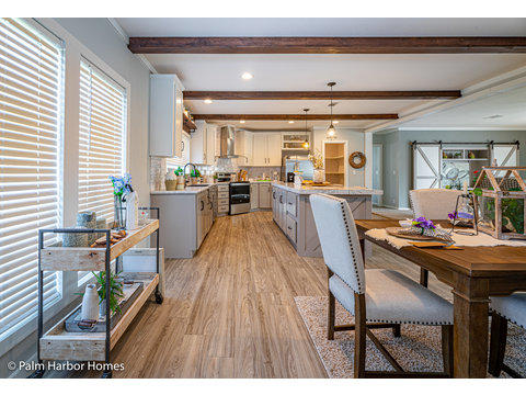 The dining room of the Magnum home - a manufactured home by Palm Harbor Homes - with 4 Bedrooms, 2 Baths - www.palmharbor.com