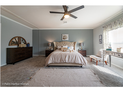 The master bedroom of the Magnum home - a manufactured home by Palm Harbor Homes - with 4 Bedrooms, 2 Baths - www.palmharbor.com