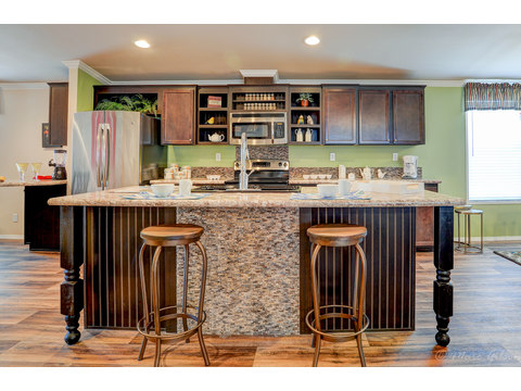 "Gorgeous eat-in bar in kitchen with ""scuff proof"" area by foot area in the La Sierra II VRT476E1 Triple wide manufactured home by Palm Harbor Homes, with 4 Bedrooms, 2 Baths, 2,077 Sq. Ft."