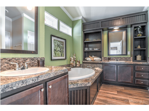 The master bathroom is a dream spa!  Big soaker tub.  Giant shower. Storage. Love the La Sierra II VRT476E1 Triple wide manufactured home by Palm Harbor Homes, with 4 Bedrooms, 2 Baths, 2,077 Sq. Ft.