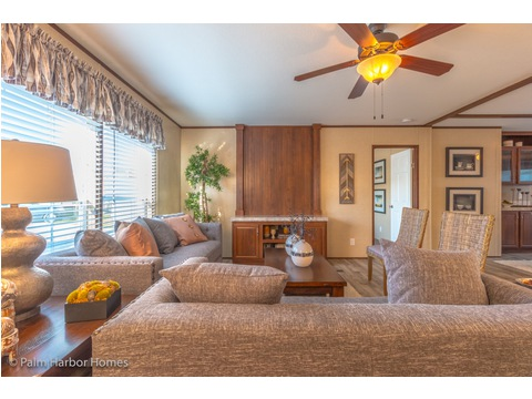 Living room - Velocity Model 32523V - with built-in entertainment area.  Double wide manufactured home available from Palm Harbor Homes.