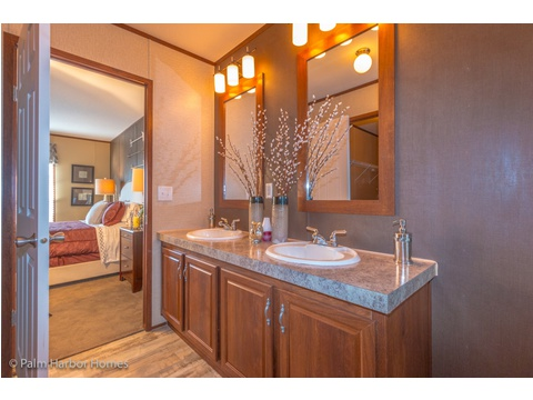 From the master bath back into the master bedroom in the Velocity Model 32523V - a double wide manufactured home available from Palm Harbor Homes