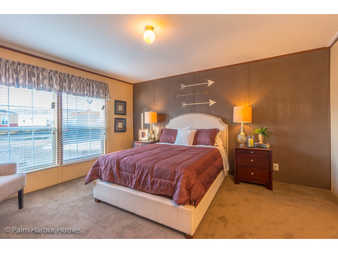 Large, well-let master bedroom in the Velocity Model 32523V - a double wide manufactured home available from Palm Harbor Homes