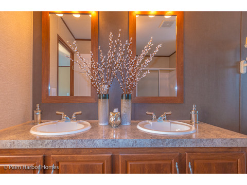 Beautiful mirror treatments in this double sink area in the master bath of the Velocity Model 32523V - a double wide manufactured home available from Palm Harbor Homes