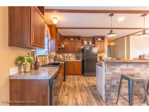 The primary traffic area in the kitchen of the Velocity Model 32523V - a double wide manufactured home available from Palm Harbor Homes