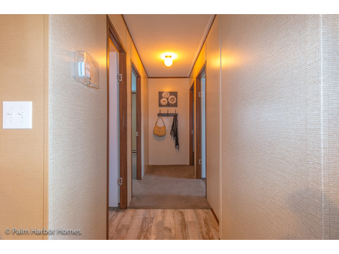 Hallway to the secondary bedrooms in the split floor plan layout of the Velocity Model 32523V - a double wide manufactured home available from Palm Harbor Homes