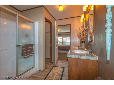 Large shower and walk-in closet in the master bedroom in the Velocity Model 32523V - a double wide manufactured home available from Palm Harbor Homes