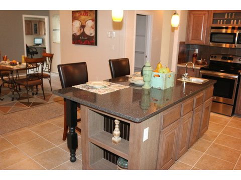 Tons of additional storage in the kitchen island.  The Casa Grande by Palm Harbor Homes - 4 Bedrooms, 3 Baths, 2520 Sq. Ft.