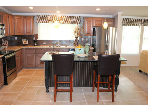 A sit-in island in the Kitchen.  The Casa Grande by Palm Harbor Homes - 4 Bedrooms, 3 Baths, 2520 Sq. Ft.