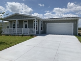 Cumberland II manufactured home by Palm Harbor Homes in Florida.  Shown with garage added by others.
