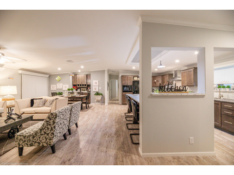 The Malibu's open floor plan in the common living area provides plenty of seating areas for family and guests, as well as great access to natural lighting with the window placement.