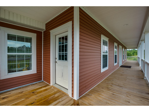 Nice wide friendly covered porches on the Greenbrier modular home is a Palm Harbor model built by Nationwide Homes. Beautiful full porch and 3 Bedrooms, 2 Baths, 1,978 Sq. Ft.