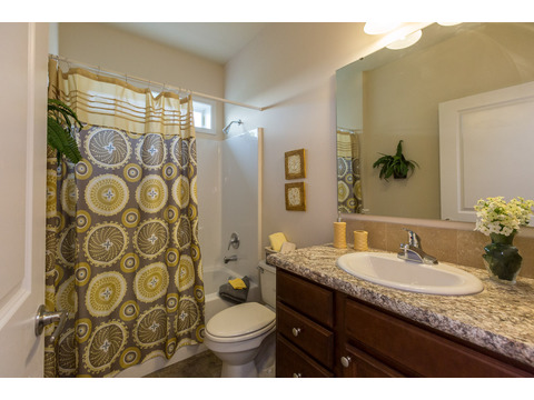 Secondary bathroom in the Greenbrier modular home is a Palm Harbor model built by Nationwide Homes. Beautiful full porch and 3 Bedrooms, 2 Baths, 1,978 Sq. Ft.