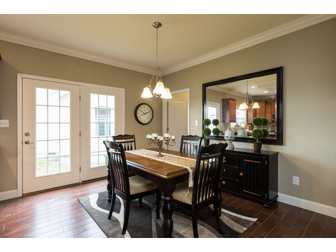 Dining area adjacent to double french doors in the Greenbrier modular home is a Palm Harbor model built by Nationwide Homes. Beautiful full porch and 3 Bedrooms, 2 Baths, 1,978 Sq. Ft.