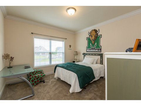 Secondary bedroom in the Greenbrier modular home is a Palm Harbor model built by Nationwide Homes. Beautiful full porch and 3 Bedrooms, 2 Baths, 1,978 Sq. Ft.
