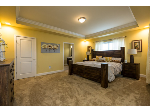 Large and luxurious master bedroom suite - and check out that ceiling in the Greenbrier modular home is a Palm Harbor model built by Nationwide Homes. Beautiful full porch and 3 Bedrooms, 2 Baths, 1,978 Sq. Ft.