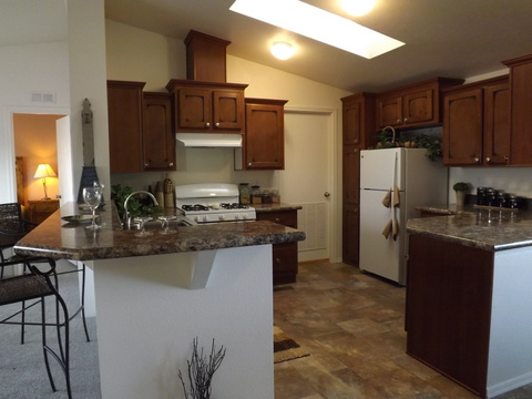 Great kitchen layout with access to the utility room in the DN-28564A model manufactured home