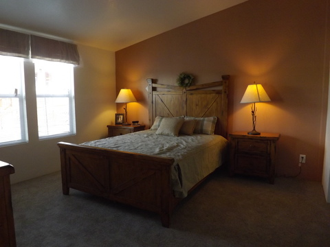 Large master bedroom with big windows, a walk-in closet and more in the DN-28564A manufactured home