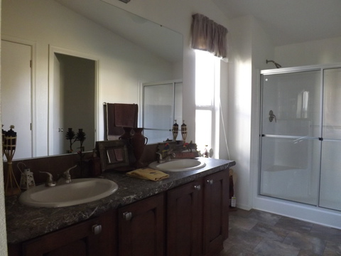 More great windows in this master bath with large walk-in shower, double sinks and more in the DN-28564A manufactured home