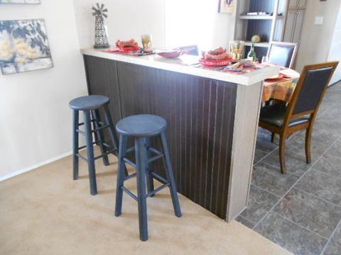 Need more seating for a couple of extra guests? No problem..this is the perfect area for a couple of bar stools. Another way Palm Harbor Homes allows you to utilize space. Call 1-888-466-3718 to find a model center near you. - The Aspen FFI376W9