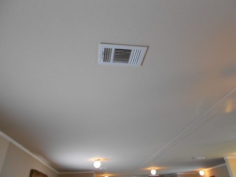 In the Aspen Manufactured home ALL of the A/C vents are in the ceiling. No more arranging furniture around floor vents.