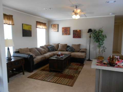 This Aspen Manufactured home has a huge living room! The home is an 18 wide with tons of room! You can bring all your furniture with you when you move in to this home!! Call 1-888-466-3718 to find a model center near you...