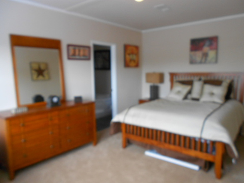 The Aspen Manufactured home by Palm Harbor Homes features a very large and spacious master bedroom. You will have no problem fitting your king-size bed, night stands and dresser in this room.