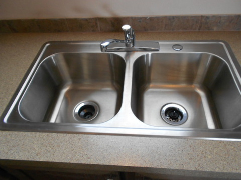 Check out the large, deep, stainless steel kitchen sink. Easy to keep clean! Call 1-888-466-3718 to find a model center near you. - The Aspen FFI376W9 by Palm Harbor Homes