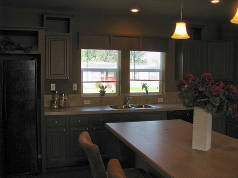 The Dream Maker Manufactured home has a wonderful Island kitchen with tons of cabinet and counter top space!