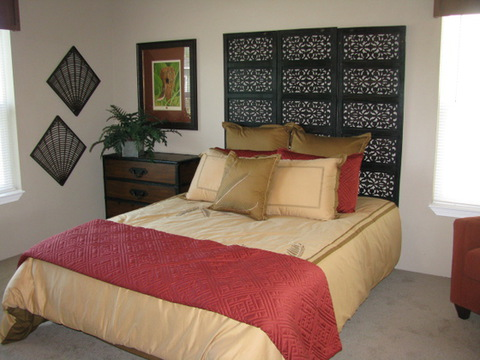 The Dream Maker by Palm Harbor Homes has a stunning master suit with space to accommodate all of your furniture needs!!