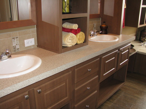 Beautiful master bathroom with dual vanities and built-in shelving...Call 1-888-466- 3718 to find a Palm Harbor Model Center near you.