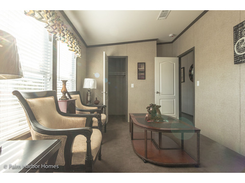 Guest bedroom with walk-in closet - The Super Saver Benbrook SA28644B by Palm Harbor Homes