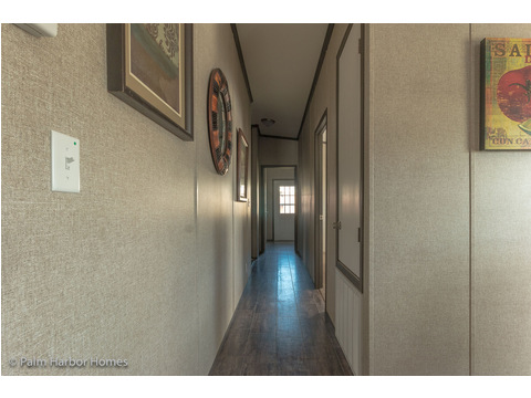 Hallway to secondary bedrooms - The Super Saver Benbrook SA28644B by Palm Harbor Homes