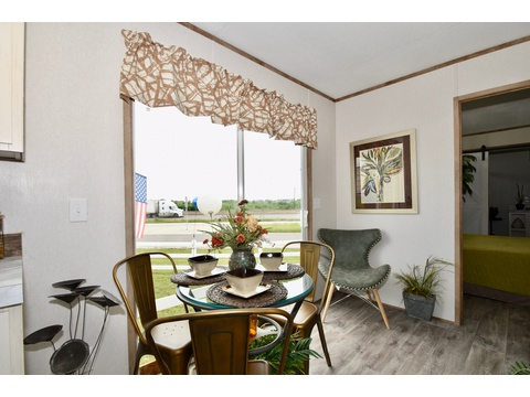 Breakfast nook in the Celebration 5C16602F - 930 sq ft by Palm Harbor Homes.