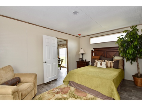 Master bedroom in the Celebration 5C16602F - 930 sq ft by Palm Harbor Homes.