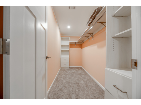 Walk in closet in master suite - Tradewinds by Palm Harbor Homes