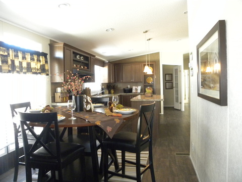 This gigantic kitchen includes a center island countertop as well as a dining area - The Appaloosa GLP356A1 by Palm Harbor Homes