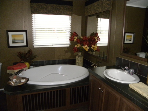 Master bathroom with huge tub and walk in shower - The Appaloosa GLP356A1 by Palm Harbor Homes
