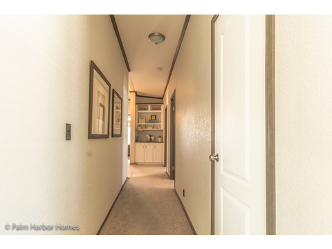 Hallway to family room and secondary bedrooms - The Carrington 76 Model ML30764C by Palm Harbor Homes