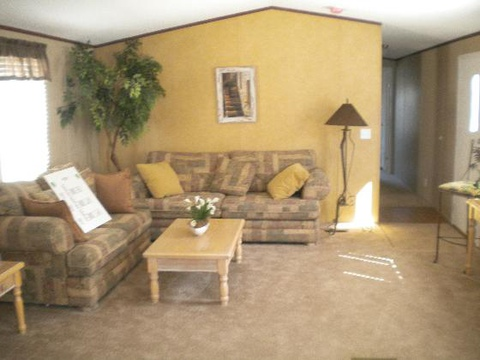 The Pinehurst II TLG372F4 living area. Picture of home by manufactured/modular builder Palm Harbor.