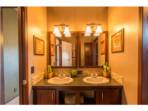 Even the guest bathroom has dual vanities in the Homerun model by Palm Harbor!