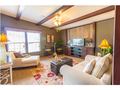 The Homerun model is shown here with the OPTIONAL spacious Family Room with ceiling beams.  See floor plan on this page for other optional room configurations including a media room.