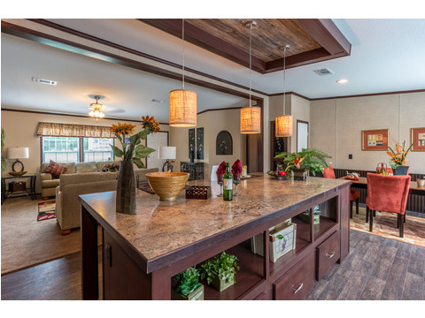 This HUGE kitchen island in the Homerun model is not only great for meal prep, but look at the built in shelving on the end and all the space for bar area seating! The Homerun HRT472A6 or HR30724R -