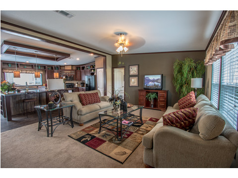 Another view of this spacious living area in The Homerun model by Palm Harbor Homes. The Homerun HRT472A6 or HR30724R - 4 Bedrooms, 2 Baths, 2,160 Sq. Ft.