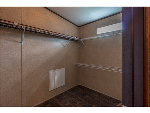 HUGE master closet in the Homerun - - with an elevated window for natural lighting.